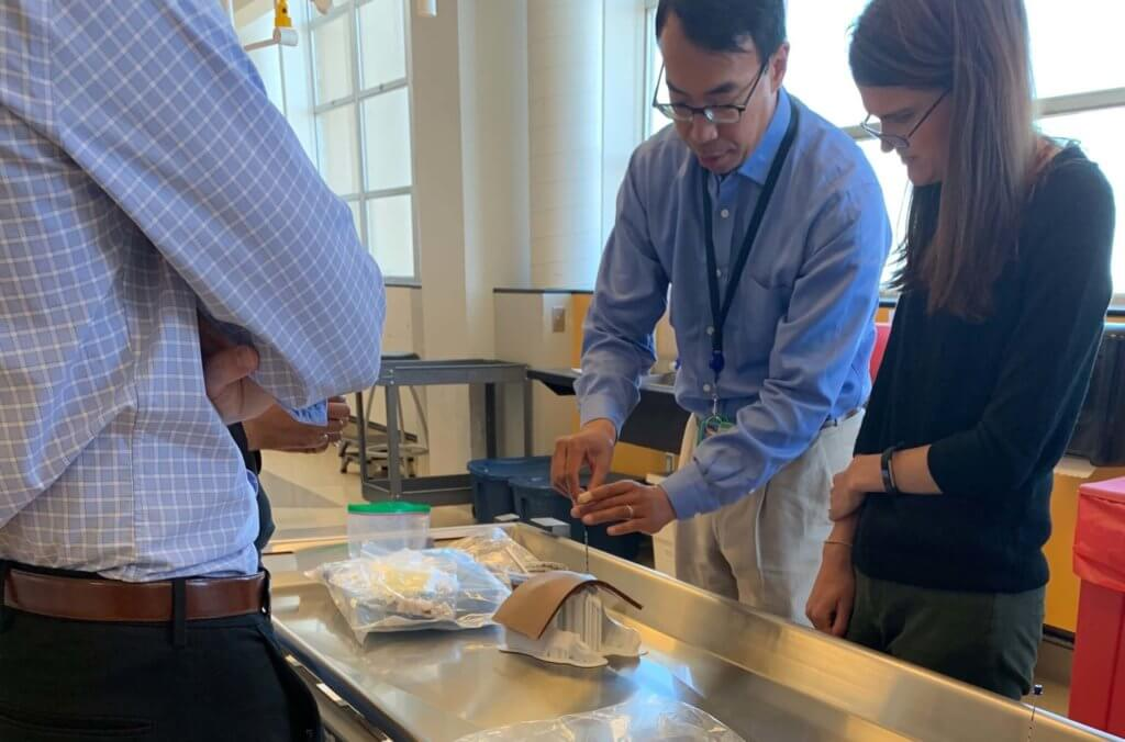 Faculty and residents practicing biopsy simulation using 3D printed models.