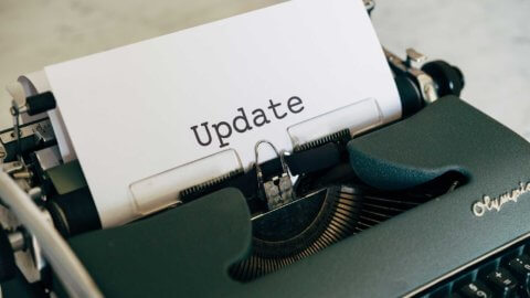 typewriter with paper that says Update
